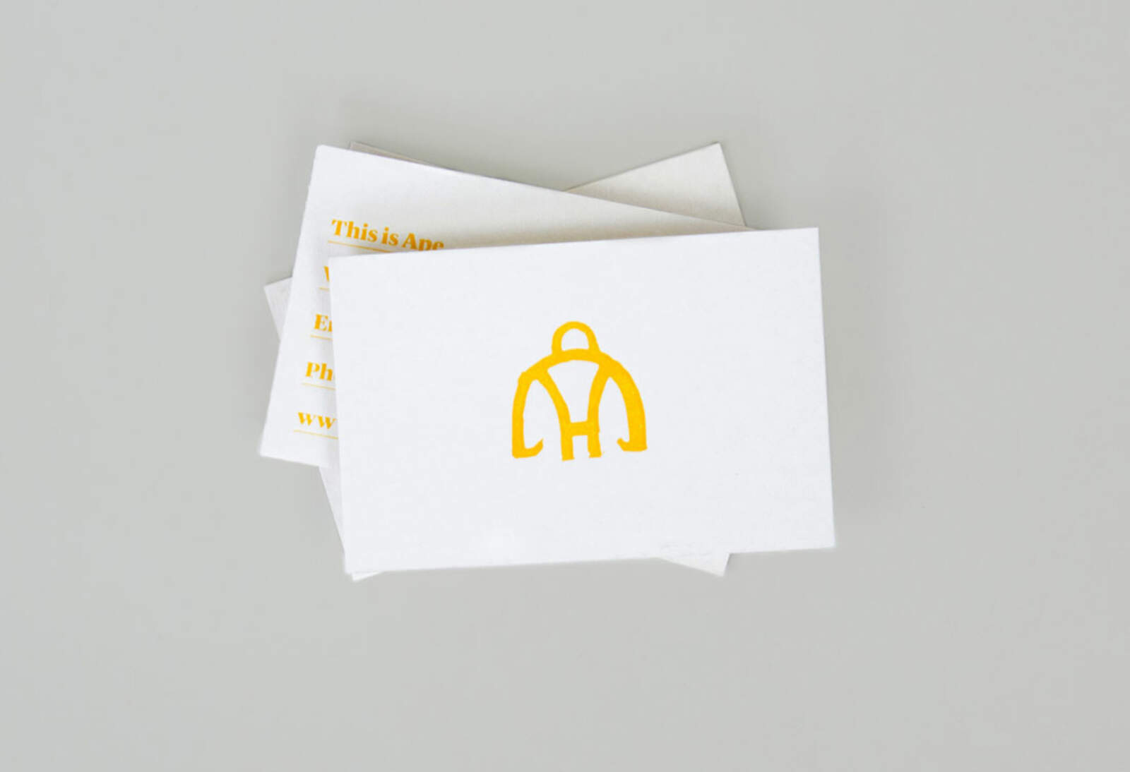 Ape branding used on business cards, front side with large logo.