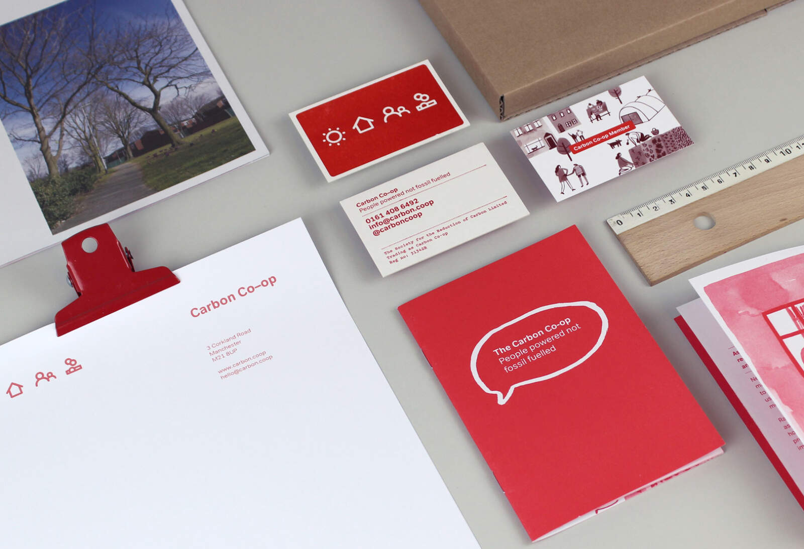 Carbon Coop branding applied to various stationery — letter heads, booklets, business cards, etc.