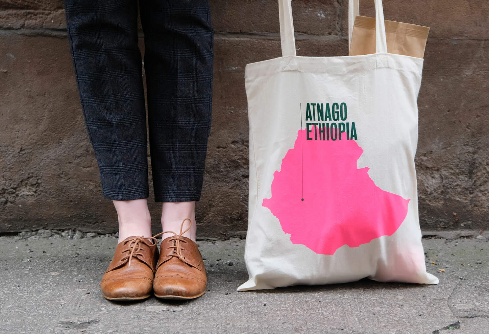 Passion Fruit branding applied to a tote bag.