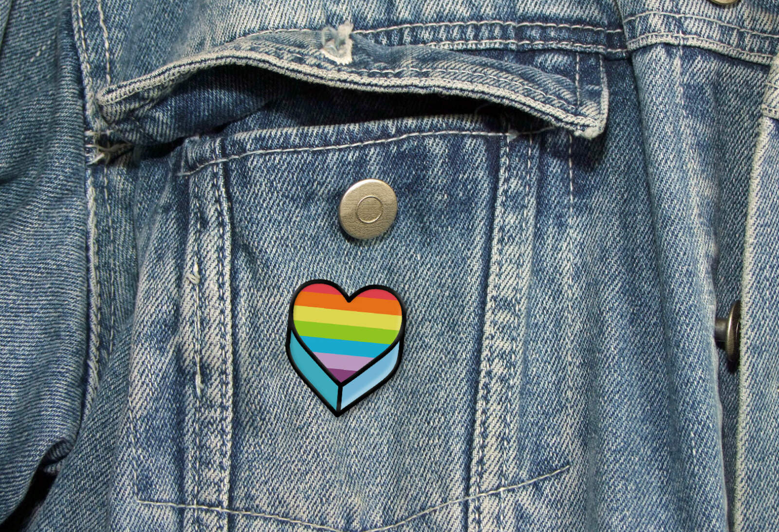 A Penguin Pride pin badge.
