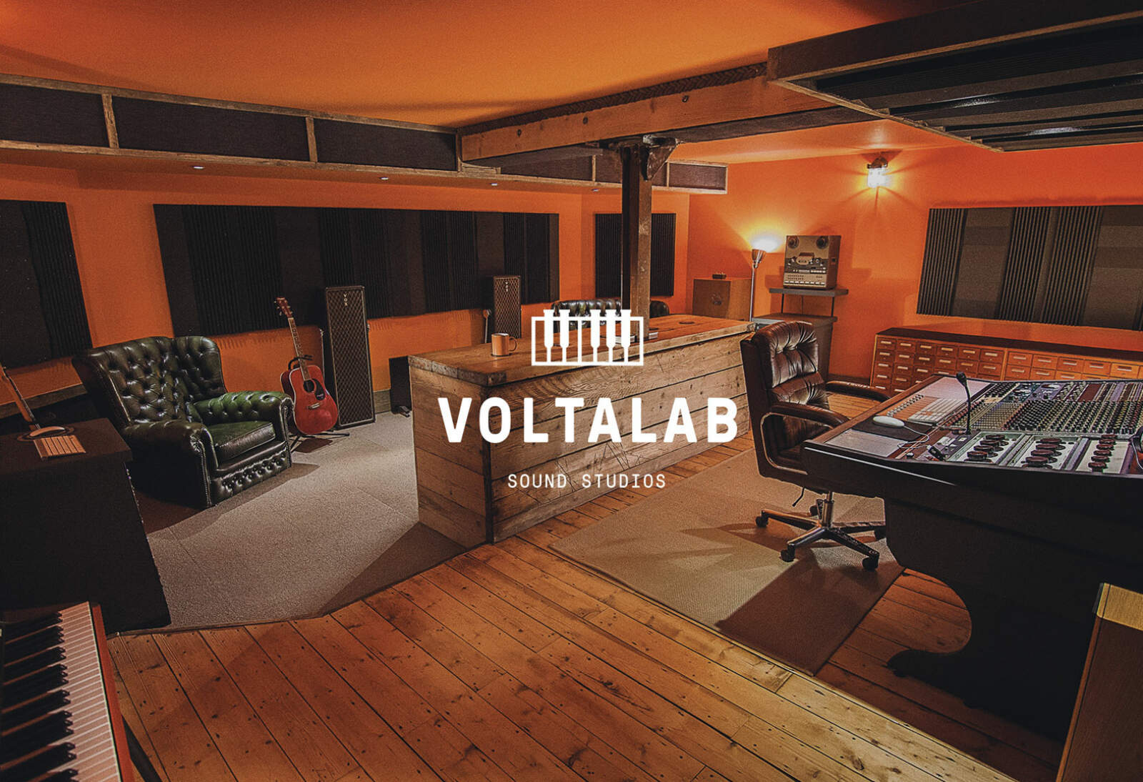 Voltalab logo overlaid on a brand photography of the recording studio.