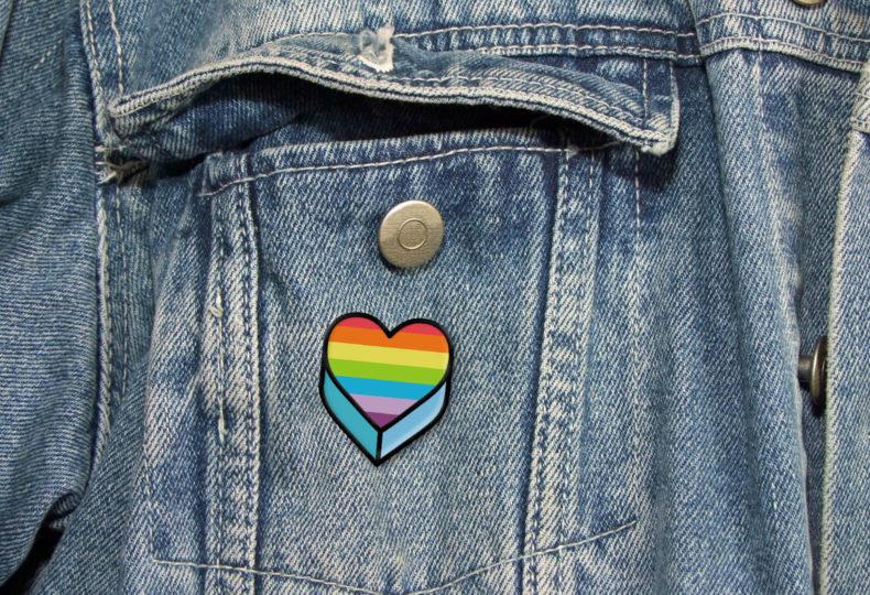 A Penguin Pride pin badge.