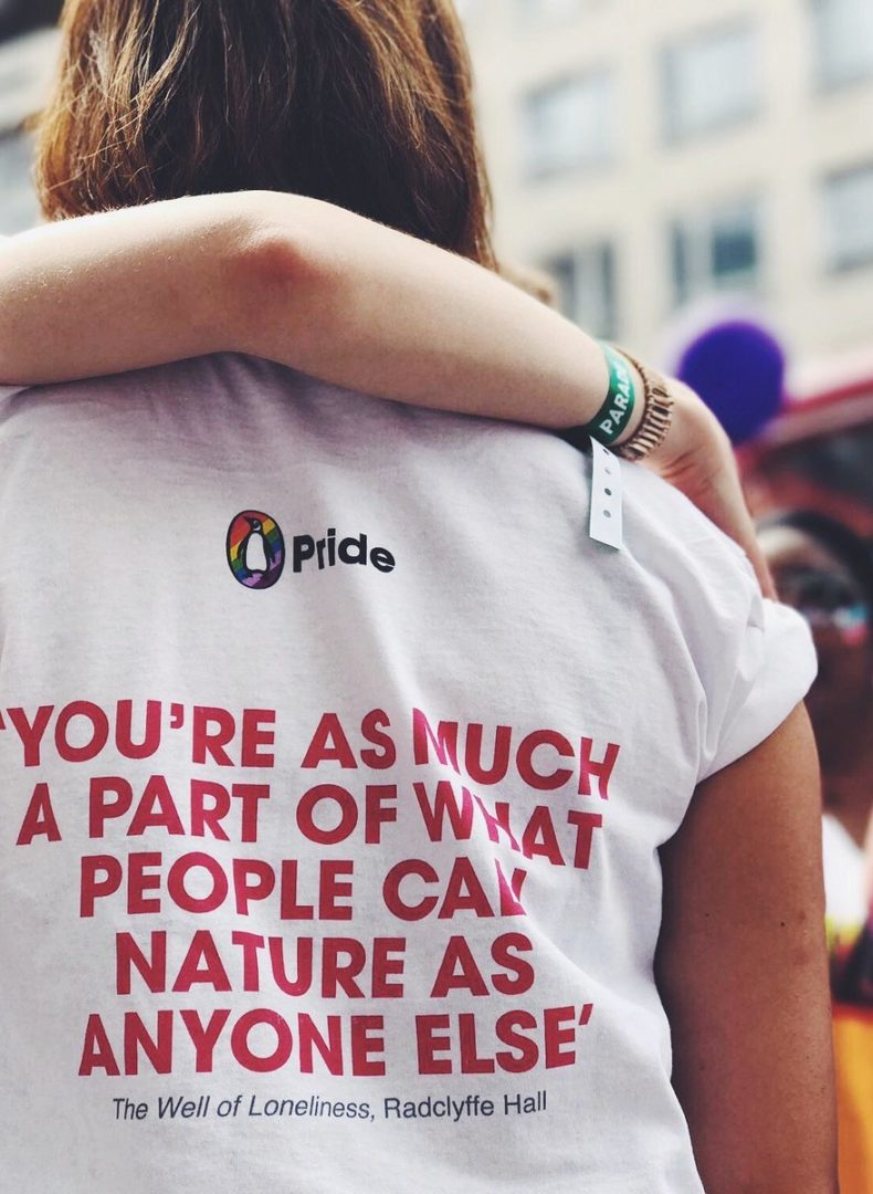 Someone wearing a Penguin Pride tee-shirt at the Manchester Pride festival.