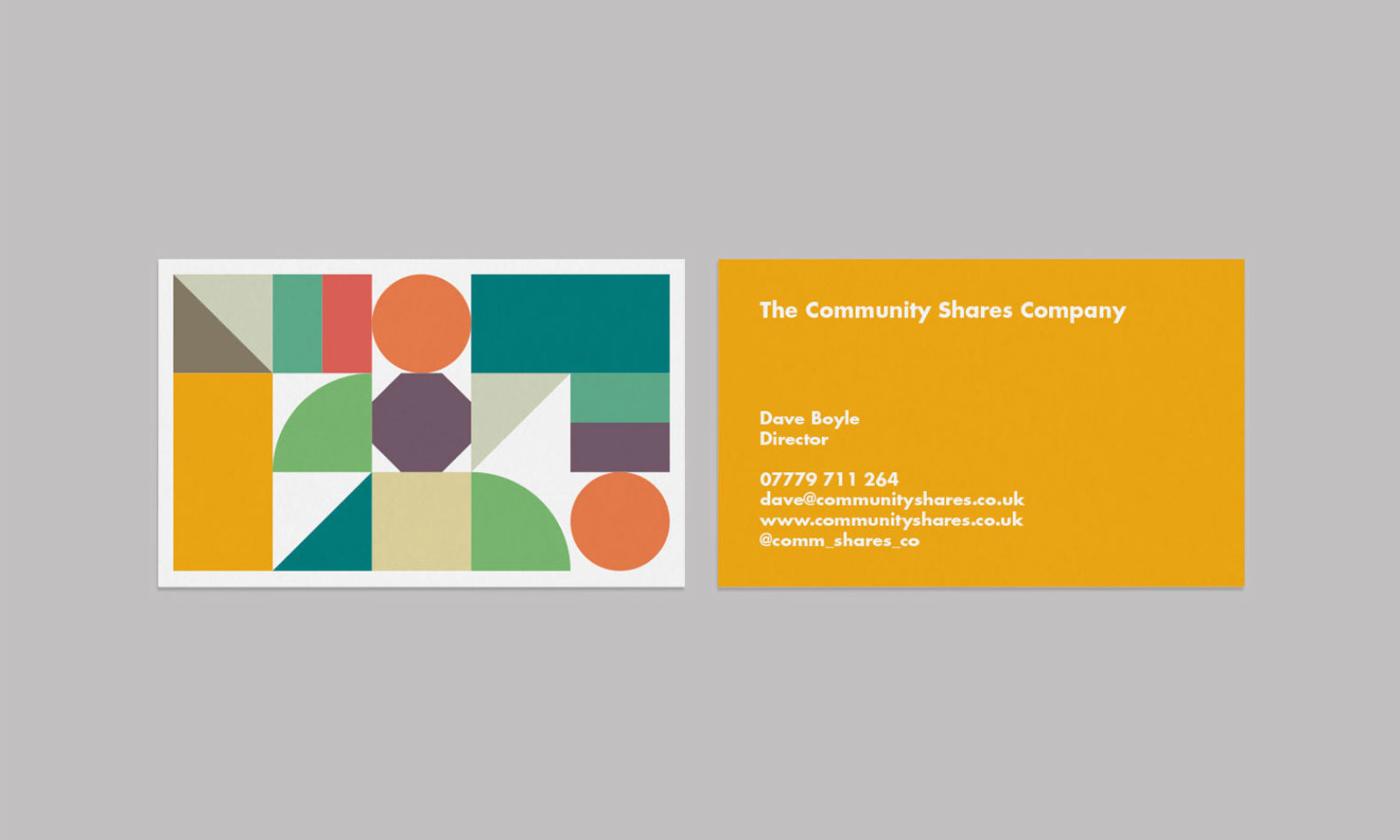 Geometric branding system for Community Shares used on their business card.