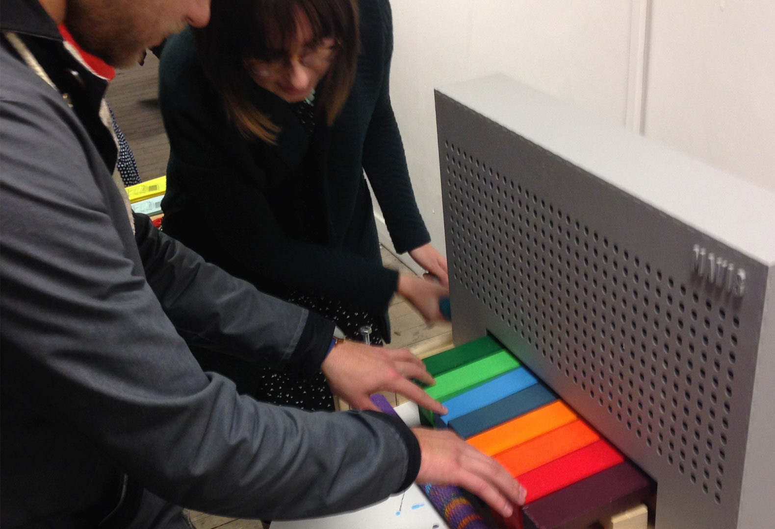 People playing with the MAVIS musical printing machine.