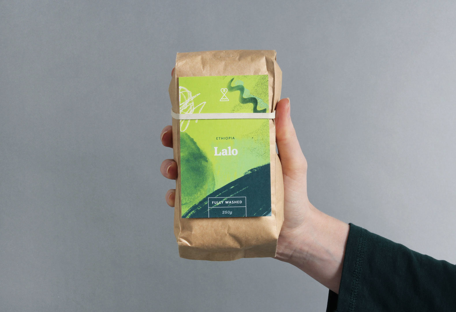 Passion Fruit branding design system used to label a pack of coffee beans.