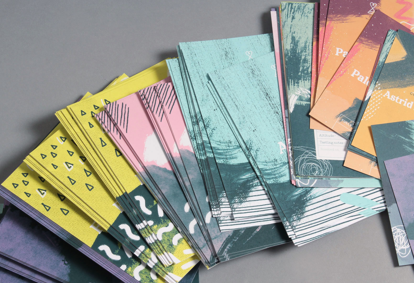 Scattered coffee pack label cards for Passion Fruit.