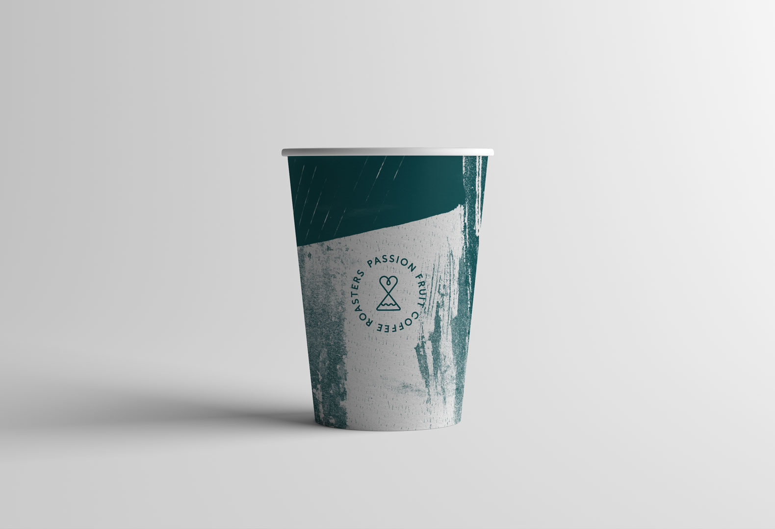 Passion Fruit branding system used on a paper coffee cup.